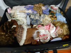 Suitcase and Contents of Pot Face Dolls