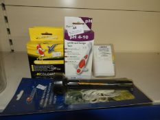 Six Water Testing Kits and a Thermometer