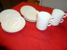 *stacking coffee cups and saucers approx. 48 items