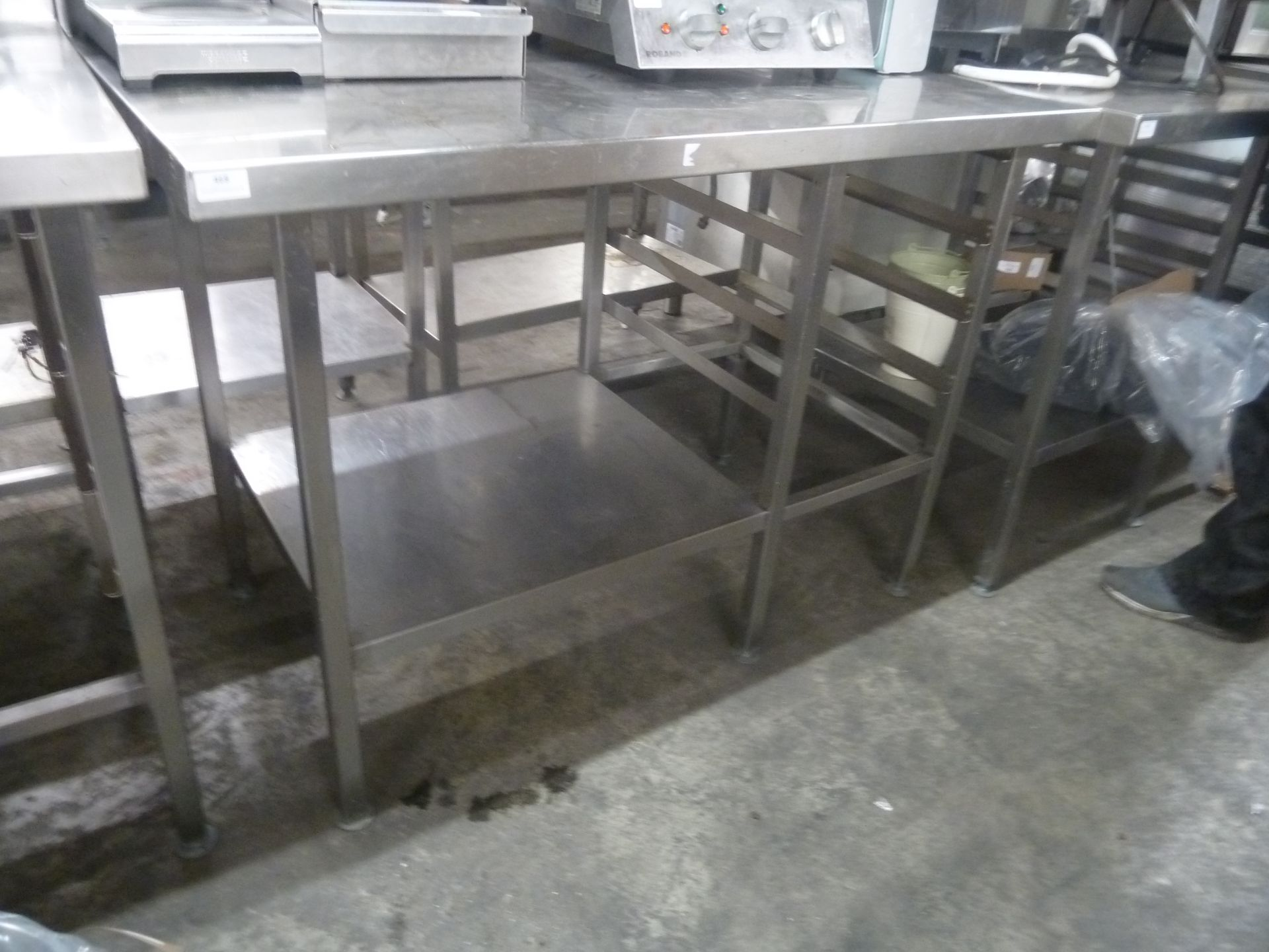 *S/S prep bench with up stand, racking and under shelf. 1200w x 700d x 880h