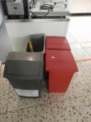 *Four Waste Bins and a Wet Floor Sign