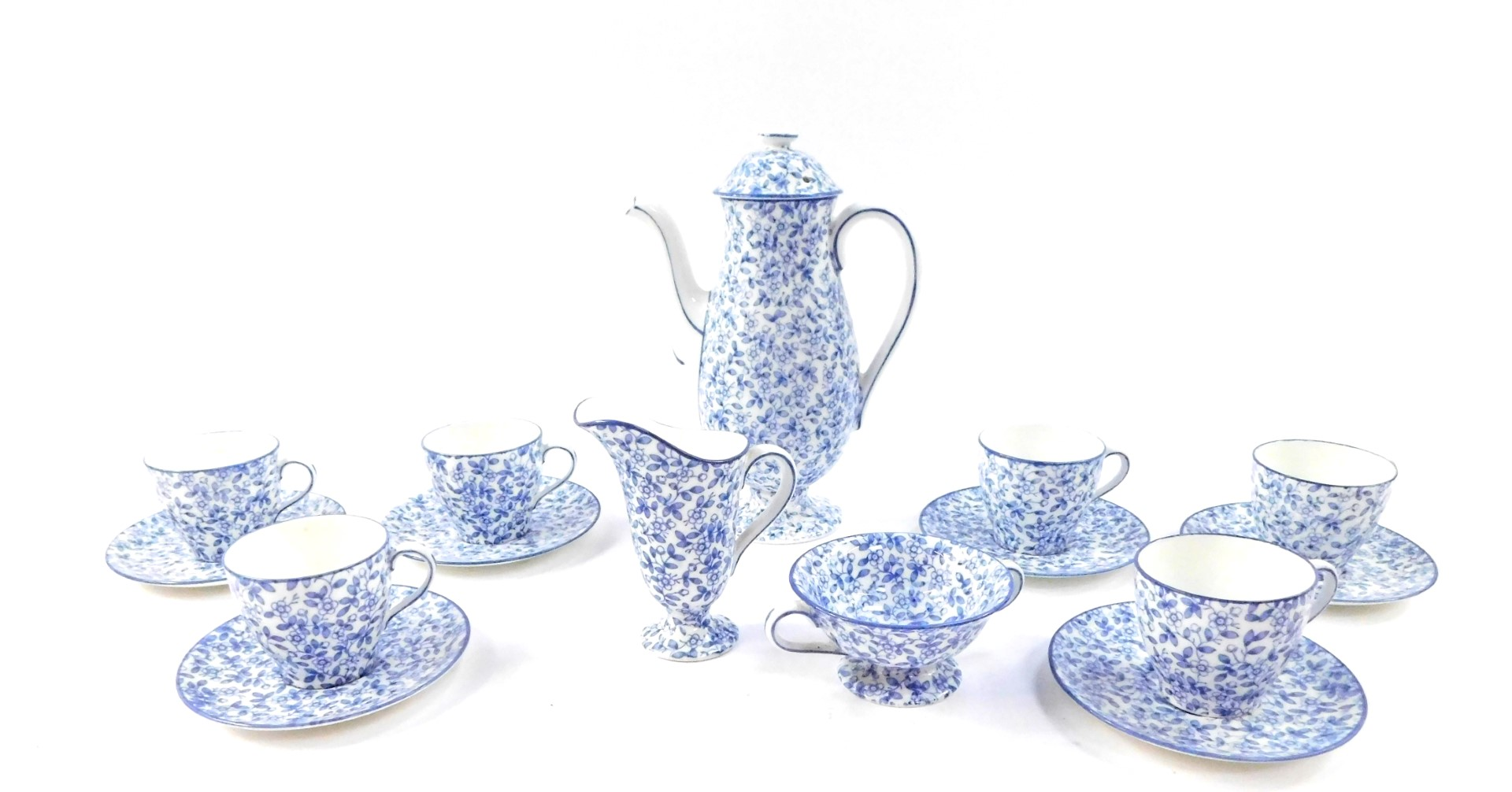 Lot 34 - A Royal Doulton early 20thC blue and white porcelain coffee service, decorated with a floral sheet