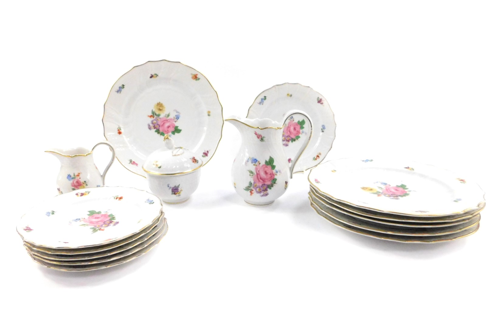 Lot 38 - A set of six Hutschenreuther early 20thC porcelain dinner plates, of fluted form, painted with