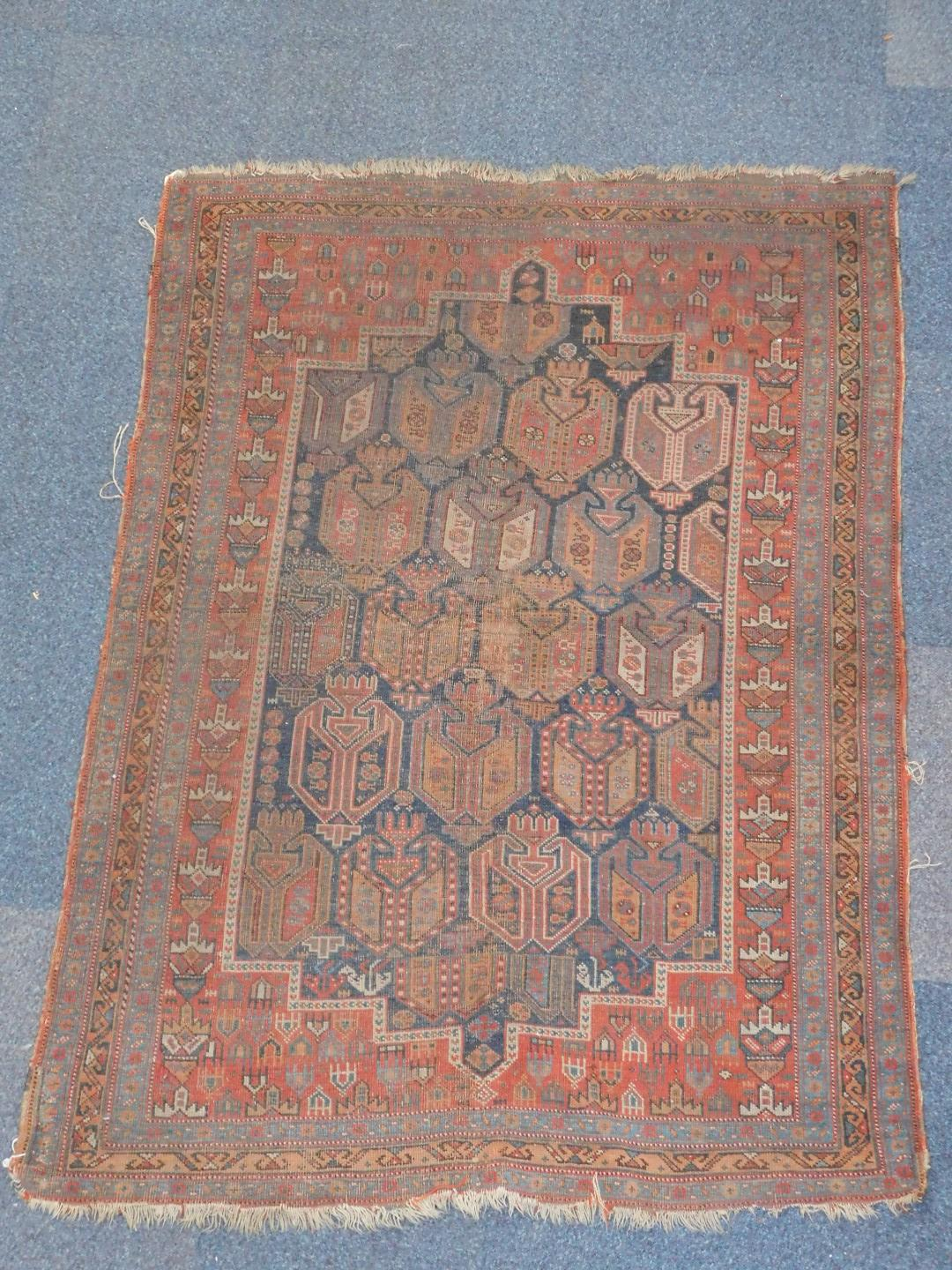 Lot 45 - A Turkish design rug, with multi gul central field on a blue ground enclosed by a red border with