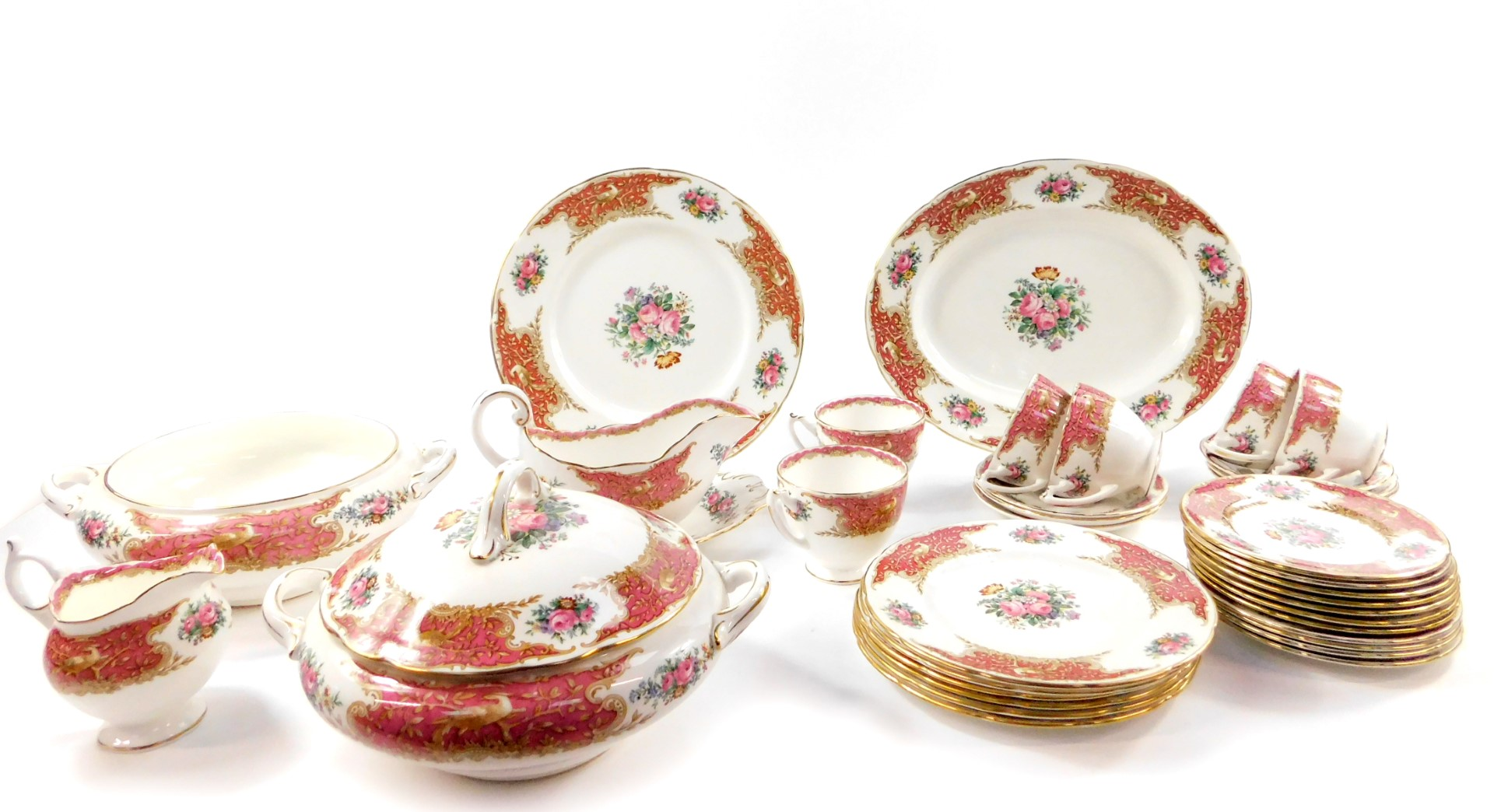 Lot 21 - A Coalport porcelain part dinner and tea service decorated in the Montrose Pink pattern,