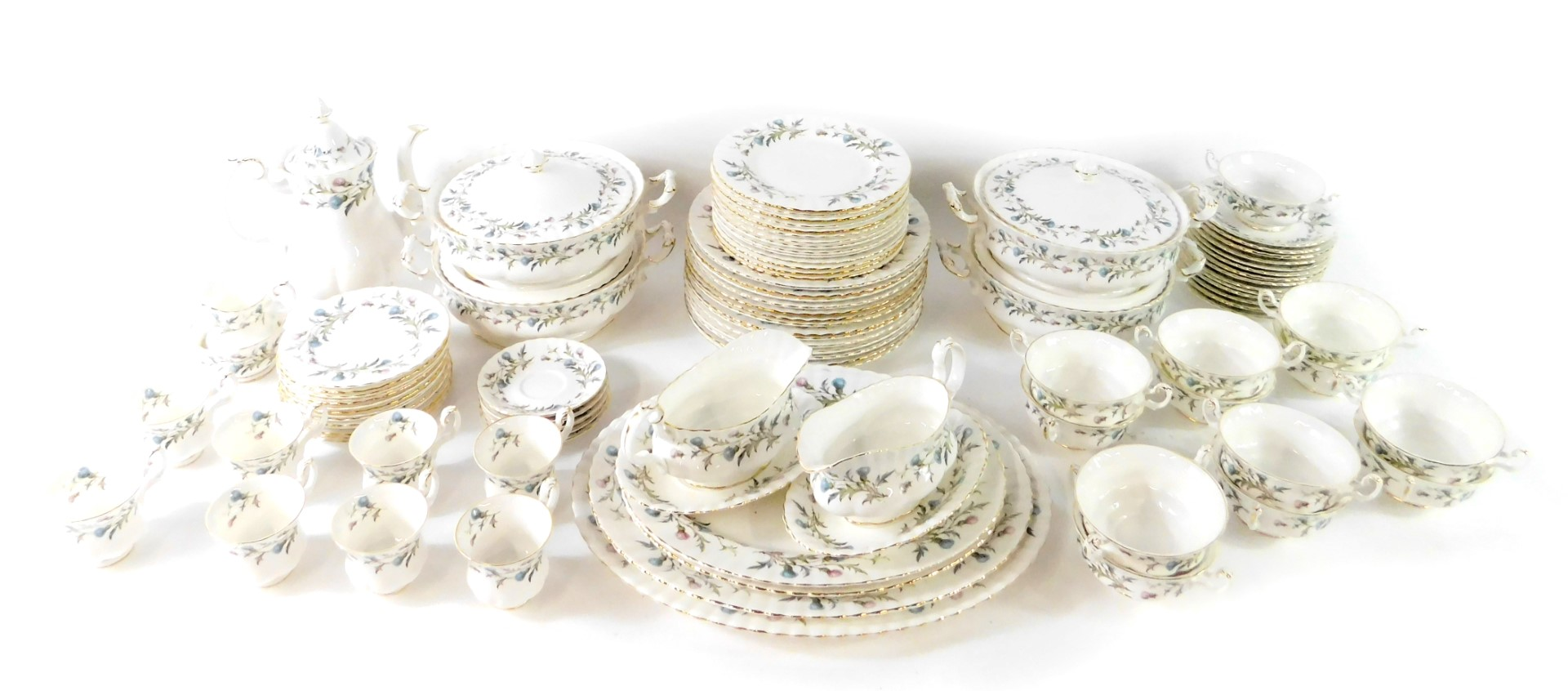Lot 25 - A Royal Albert porcelain dinner and coffee service decorated in the Brigadoon pattern, comprising