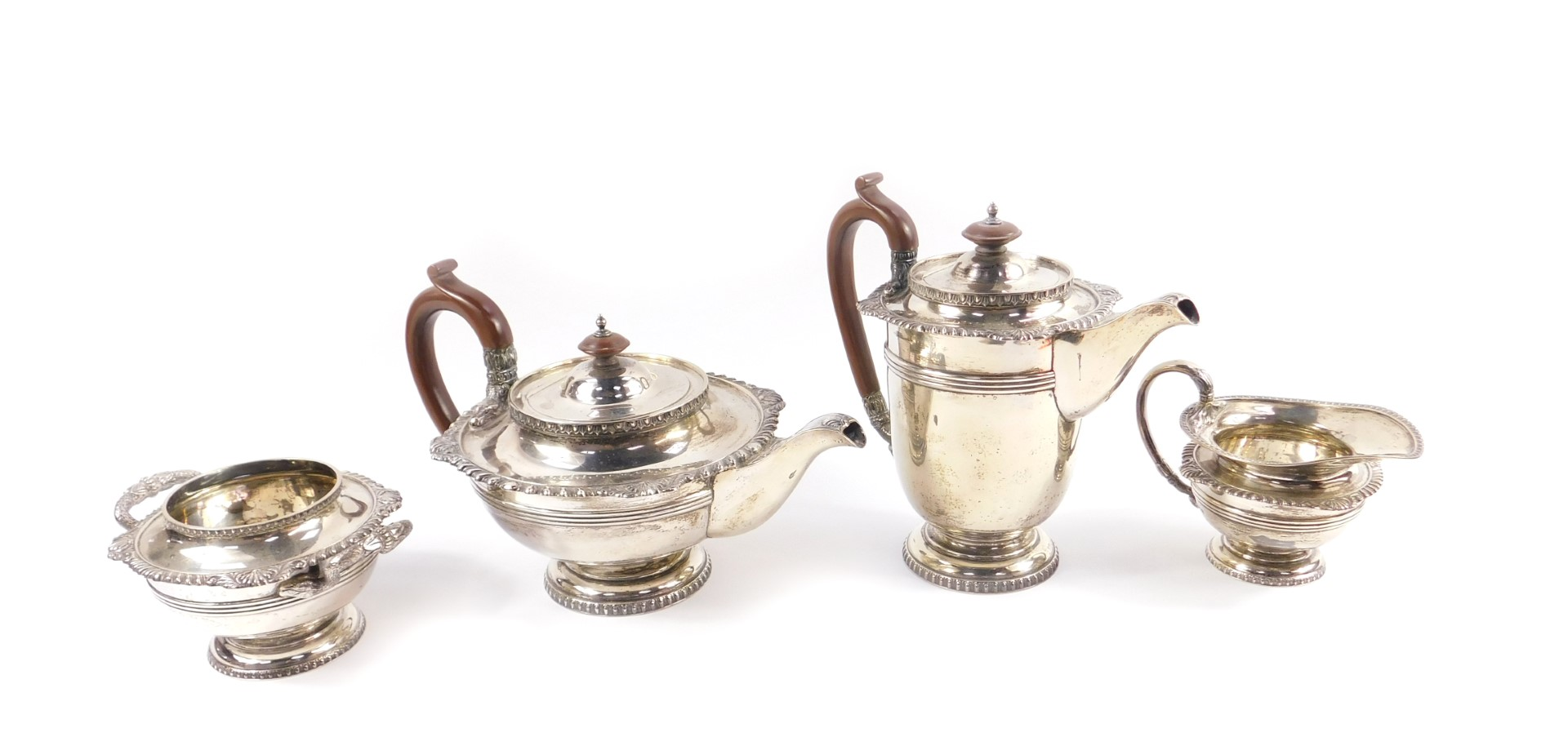 Lot 2 - A George V silver four piece tea and coffee service, of baluster form, with fluted banding, shell