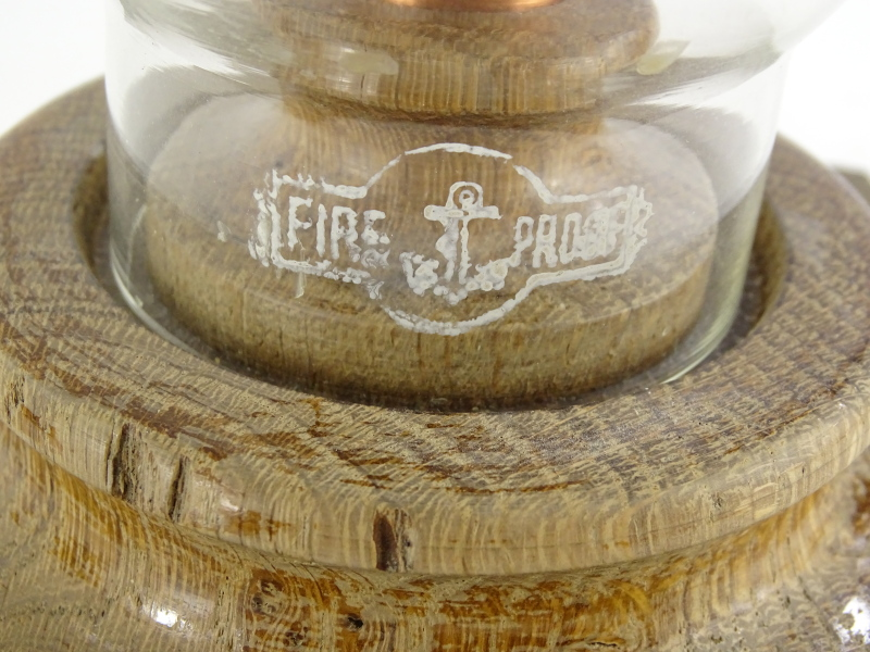 Lot 3094 - •Lincoln Cathedral treen oak candlestick, with glass shade, signed and titled verso, 29cm high.