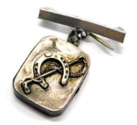 A silver horse related pendant/brooch, the small rectangular silver locket with horseshoe and riding
