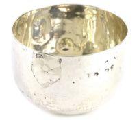 A silver coloured metal plain bowl (AF), marks indistinct, 2¼oz. Provenance: The Estate of Miss