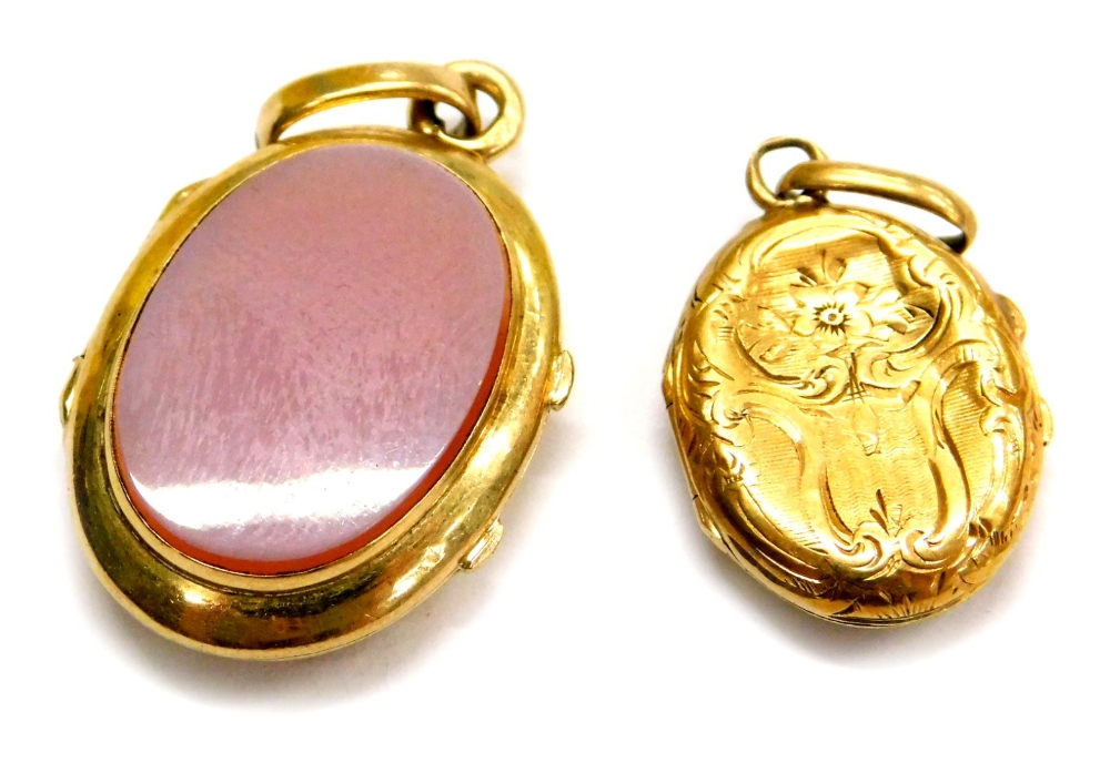 Lot 85 - Two small oval lockets, comprising a memorial oval locket, with clear panel to centre, with floral