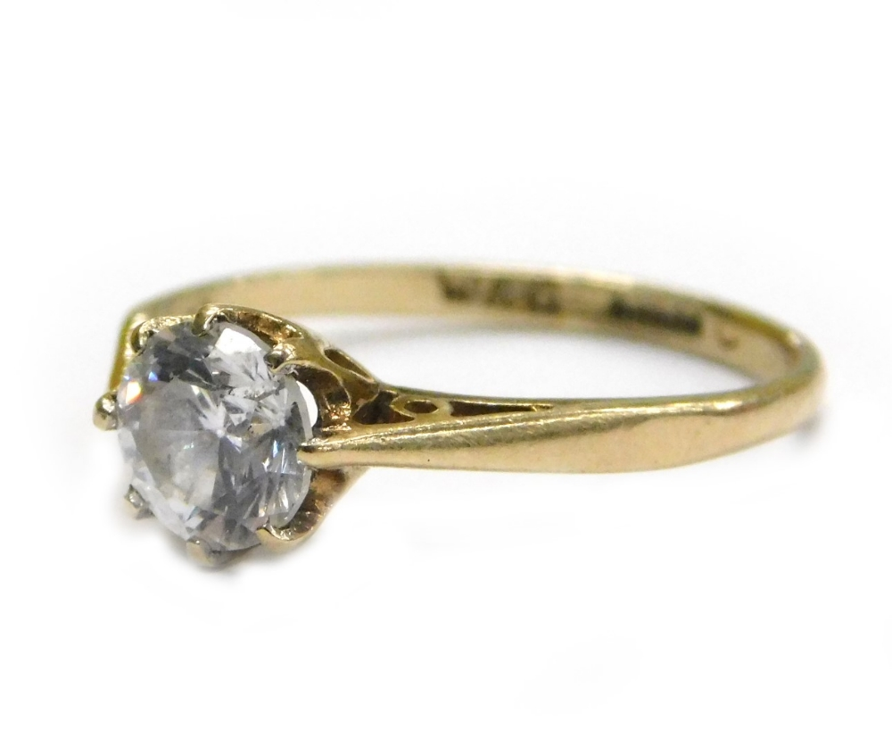 Lot 63 - A 9ct gold solitaire ring, set with imitation diamond stone, in eight claw setting, with V splayed
