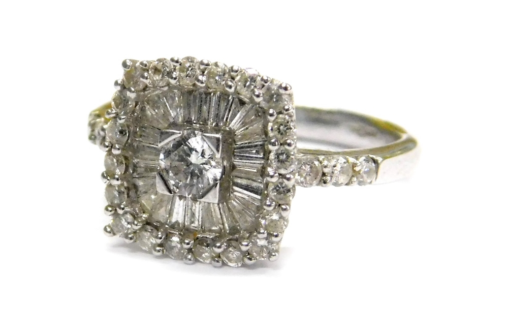 Lot 80 - An 18ct white gold and diamond dress ring, with central round brilliant cut diamond in four