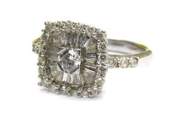 An 18ct white gold and diamond dress ring, with central round brilliant cut diamond in four