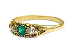 An emerald and diamond gypsy ring, set with single square cut emerald, in two claw setting, with two