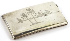 An Eastern silver coloured metal rectangular cigarette case, engraved with buildings, palm trees,