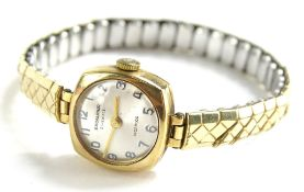 An Excalibur Incabloc ladies wristwatch, with small square set dial, and silvered backing, with