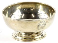 A plain silver bowl, engraved to the circular cartouche Union Club, London 1905, makers stamp to