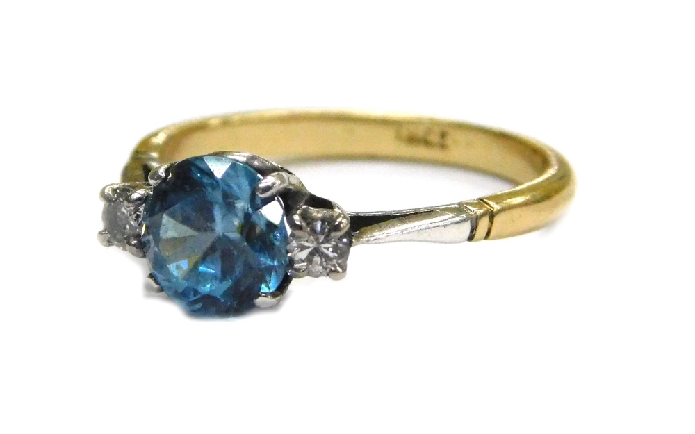 Lot 64 - An aquamarine and diamond ring, set with central round brilliant cut aquamarine, in four claw