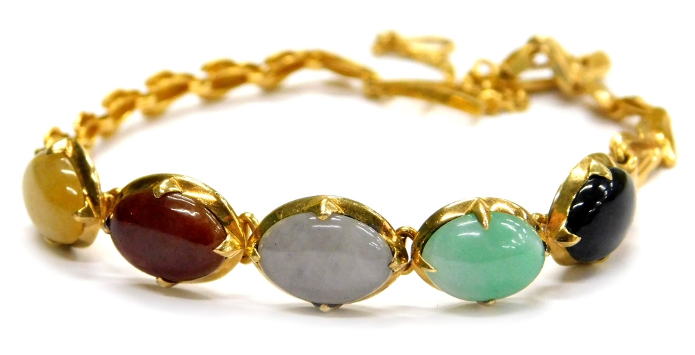 Lot 75 - A multi stone set bracelet, set with five oval semi precious stones, in a claw setting, in