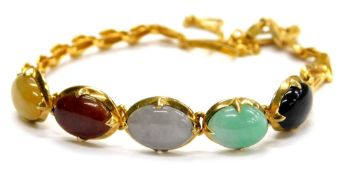A multi stone set bracelet, set with five oval semi precious stones, in a claw setting, in