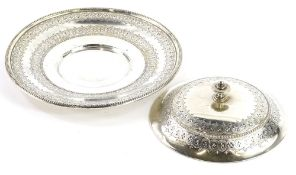 A Victorian silver butter dish, the lid and base engraved with roundels, leaves, etc., each