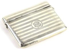 A George V engine turned silver cigarette case, with double hinged lid, Birmingham 1912, 3¾oz.