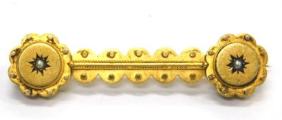 A Victorian bar brooch, with reeded and dot design, set with a single seed pearl at each end, yellow