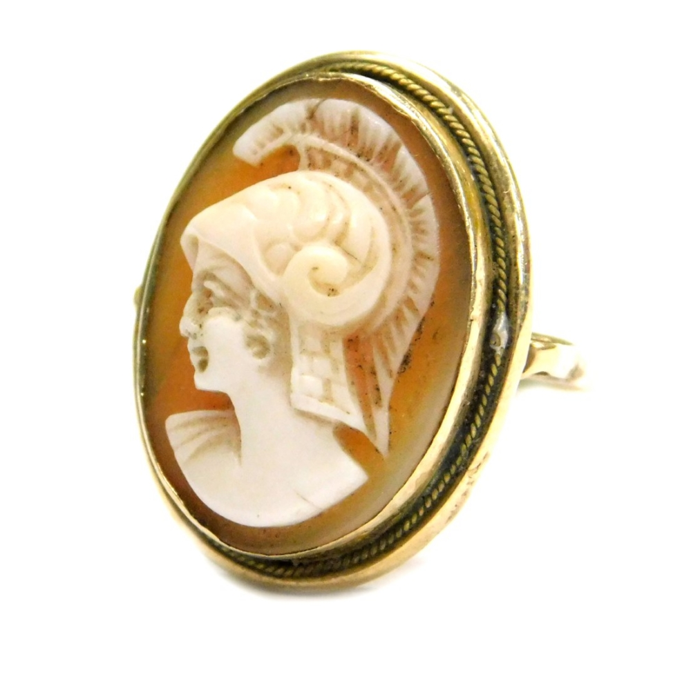 Lot 61 - A 19thC shell cameo dress ring, the oval shell cameo with figure of a warrior in headdress, in a rub