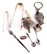 A collection of small silver etc., to include a pair of Victorian sugar tongs, a pair of early 20thC