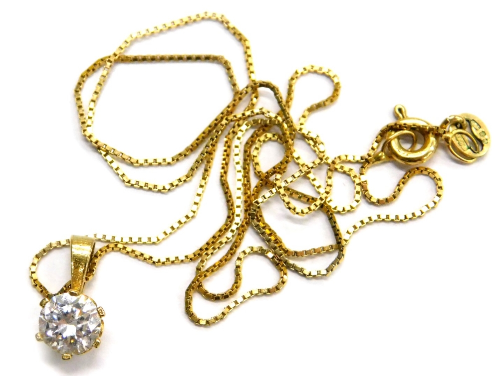 Lot 82 - A 9ct gold cubic zirconia set pendant and chain, the pendant with single CZ stone in six claw