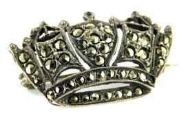 A marquasite set crown brooch, 3cm wide, marked Silver England, 4.8g all in.