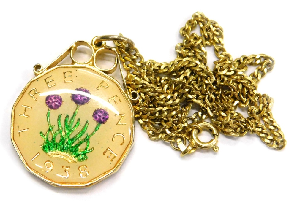 Lot 83 - A modern coin pendant and chain, with a three pence piece enamel decorated pendant, in gold plated