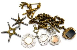 A gold plated watch chain and various silver fobs, two silver shield fobs marked 1914 and NDCL