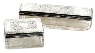 Two early Victorian cut glass and silver mounted dressing table jars, each of rectangular form, with