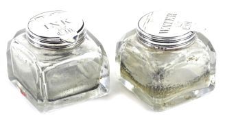 A pair of late 19th/early 20thC faceted glass inkwells, each with silver mounts, engraved for Ink