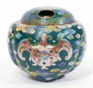 A Japanese green ground cloisonne tripod koro and pierced cover, decorated with stylized bats on a