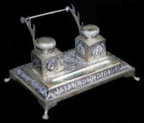 An early 20thC Indian ceremonial ink stand, of rectangular form, with space for pens and with two