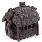A Japanese iron koro and cover, shaped as a thatched hut, with vine growing up one side, Taisho