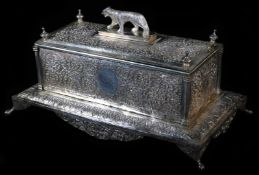 An early 20thC Indian ceremonial freedom casket, of rectangular form with tiger knop, profusely