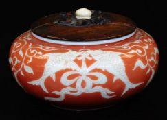 A Japanese porcelain koro, with original wood cover, decorated in coral and pale yellow enamel, with