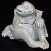 A Japanese celadon koro and cover, formed as a seated monkey with detachable head, signed to the