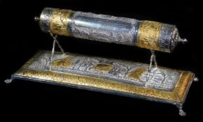 An early 20thC Indian ceremonial freedom casket, of cylindrical form on a stand, heavily repousse