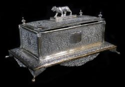 An early 20thC Indian ceremonial freedom casket, of rectangular form, with tiger knop, heavily