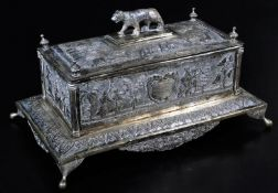An early 20thC Indian ceremonial freedom casket, of rectangular form with tiger knop, urn finials