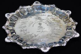 A ceremonial Indian salver, with a pie crust and heart shaped part gadrooned border, with various
