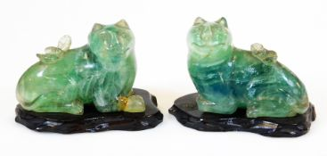 A pair of Chinese carved green quartz figures of felines, each on wood base, 19th/20thC, 8cm high.
