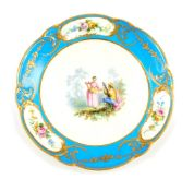 A Sevres style 19thC bleu celeste plate, painted centrally with a seated musician and a dancer in