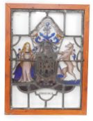 A stained glass window panel, pine framed, bearing the Coat of Arms and Motto of the City of