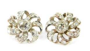 A pair of diamond floral cluster earrings, set centrally with rose cut diamonds, in a brilliant